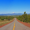 Panoramic of the Cascades from Hwy 380. Prinville Can be Seen in the Distance on Down the Road